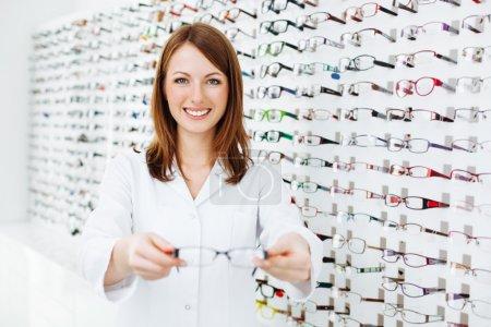 Optician presenting eyewear frames