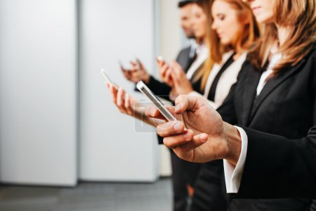 Photo for Close up of business people using smartphone. Business concept - Royalty Free Image