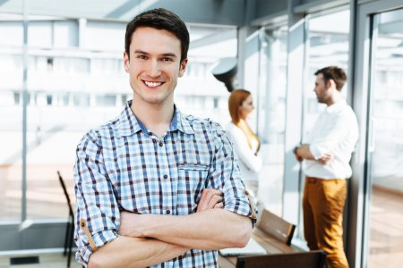 Photo for Portrait of a happy young professional in office looking at camera - Royalty Free Image