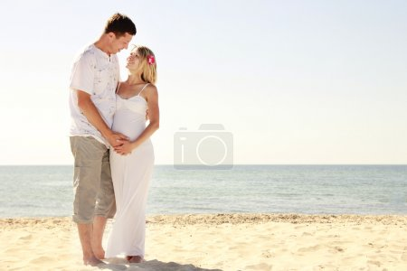 Photo for Pregnant couple in love on the beach - Royalty Free Image
