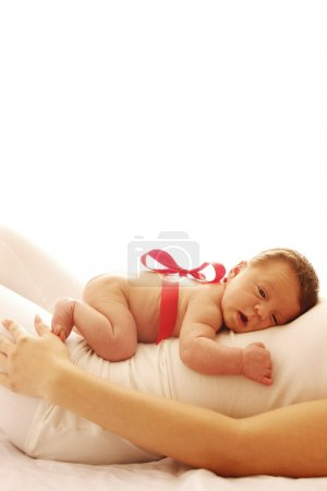 Photo for One cute little newborn baby lying on his mom - Royalty Free Image