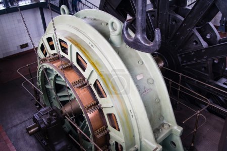 Old electric motor of the elevator for a mine shaft