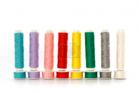 Multicolored sewing threads in a row