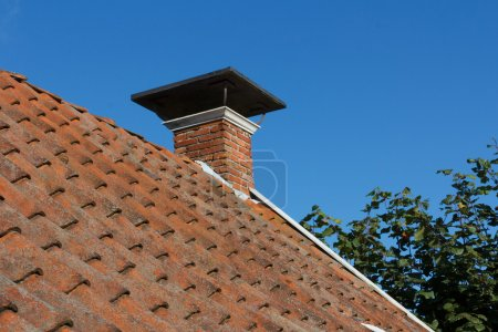 Roof and chimney on old house