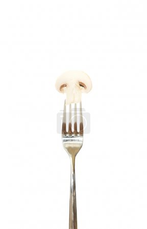 Photo for Slice of mushroom pinned on a fork against white background - Royalty Free Image