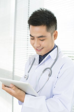 Photo for Young general practitioner taking notes - Royalty Free Image
