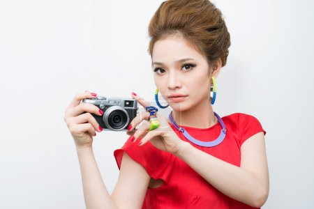 Photo for Trendy girl wearing colorful accessories taking a picture - Royalty Free Image