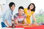 Three smiling Asians