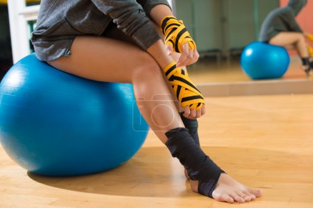 Photo for Close-up of a sportswoman sitting on a gym ball - Royalty Free Image