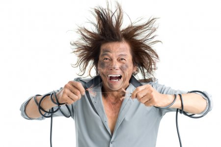 Photo for Man holding bared wires and screaming of pain - Royalty Free Image