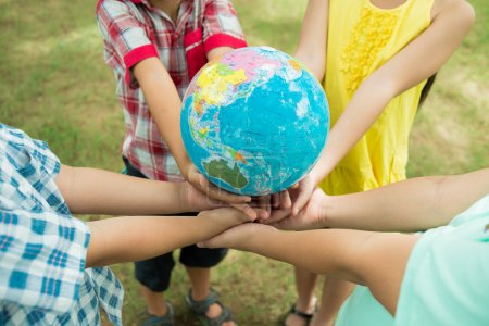 Photo for Kids holding the whole world of opportunities in their hands - Royalty Free Image