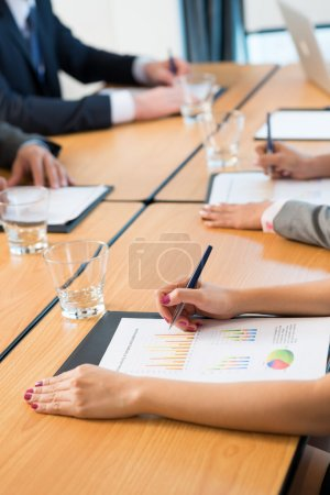 Photo for Cropped image of businesswoman at the meeting on the foreground - Royalty Free Image