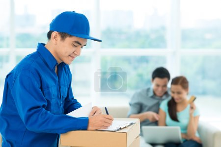 Photo for Conceptual image of a couple making an online order and a delivery guy providing the service - Royalty Free Image
