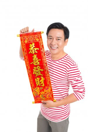 Photo for Man holding Tet textile with congratulations against a white background - Royalty Free Image