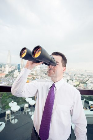 Businessman with the binoculars