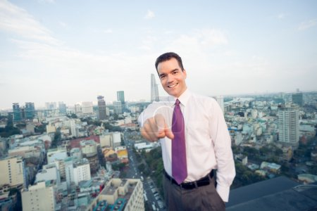 Businessman standing on the roof