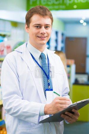 Man in pharmacy