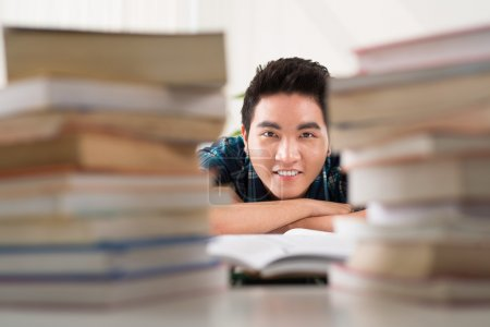 Student with books stacks
