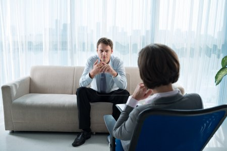 Photo for Business patient talking about his private problems at phychological session - Royalty Free Image