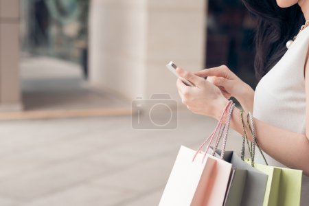 Photo for Close-up of woman using her smartphone - Royalty Free Image