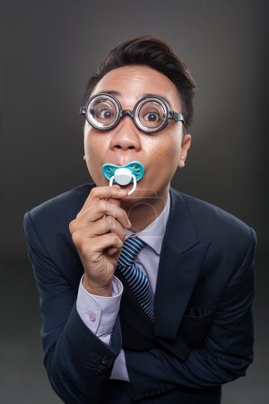 Photo for Portrait of funny businessman with a soother - Royalty Free Image