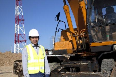 Digger standing beside excavator