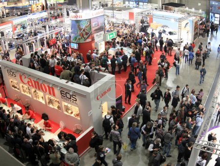 Photo for Visit Canon stand looking for cameras and lenses during PHOTOSHOW, International Photo and Digital Imagin Exhibition - Royalty Free Image