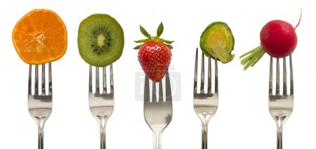 vegetables and fruits on the forks, diet concept