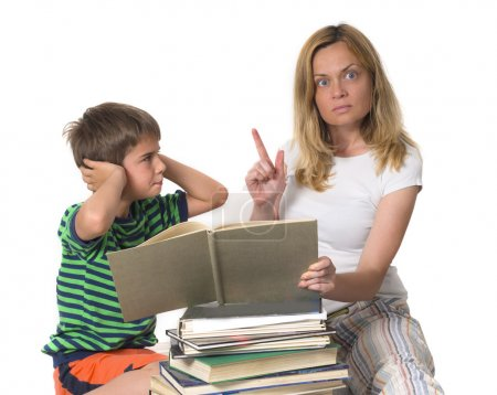 Angry mother trying to teach her son while he is confronting