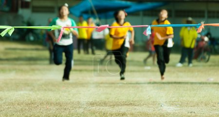 Photo for Three child girl sprinting  to finish line in sport day of school in thailand - Royalty Free Image