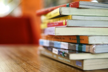 Photo for Books in Library on table - Royalty Free Image