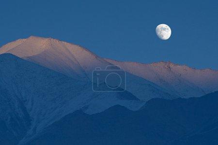 moon at Himalaya high mountain road pass Leh highway on twilight