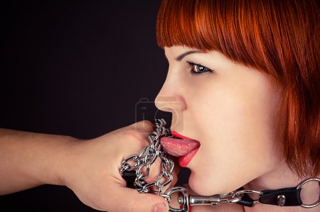 Beautiful woman as obedient slaves