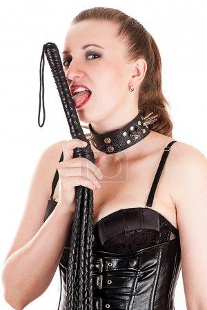 Beautiful sexy mistress licks whip