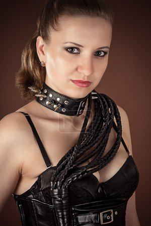 Beautiful woman in a spiked collar