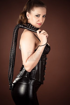 Mistress with a whip in hand