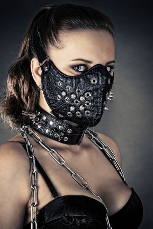 Photo for Portrait of a brutal woman with mask spikes - Royalty Free Image