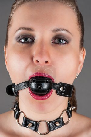 Woman gagged in the image a slave