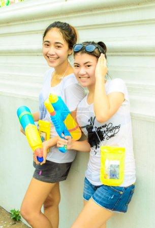 An unidentified two teen thai girl joins Thai new year celebrations near Khao San Road.