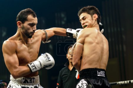 Leo Pinto of France and Mourad Harfaoui of Morocco in Thai Fight 2013.