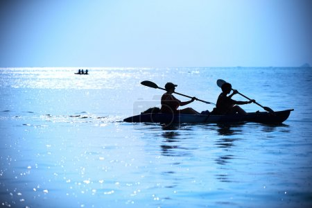two female kayaking