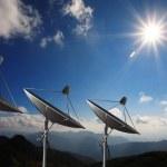 Satellite dish antennas under sky....
