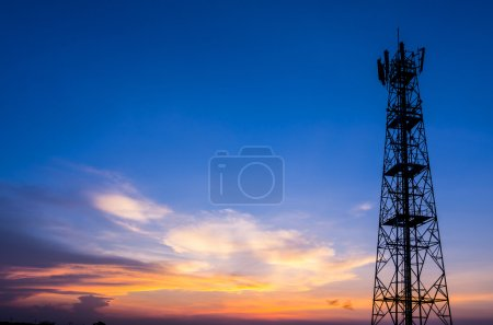 Photo for Silhouette in a large transmission tower at sunset beautiful. - Royalty Free Image