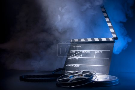 Photo for Filmmaking concept scene with clapper and dramatic lighting - Royalty Free Image