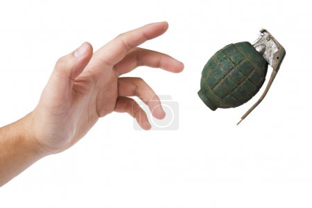 hand throwing a green grenade on white