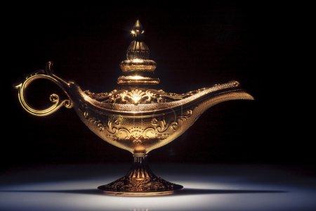 Magic Aladdin's Genie lamp on black