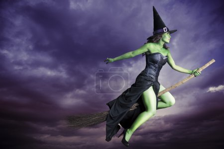 Sexy witch on a dark background...