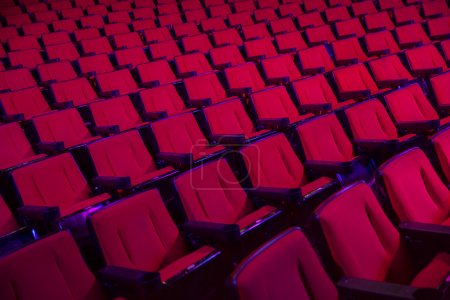 Photo for Empty rows of red theater or movie seats - Royalty Free Image