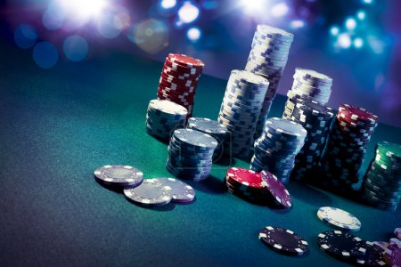 Poker Chips on gaming table