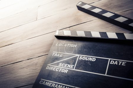 Photo for Vintage photo of movie clapper on wood - Royalty Free Image